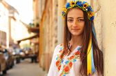 pic of poppy flower  - Pretty ukrainian girl stands and looking at camera - JPG