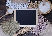stock photo of legume  - Legumes on wooden table in the kitchen - JPG
