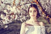 pic of flower girl  - Portrait of young woman in the flowered garden in the spring time - JPG