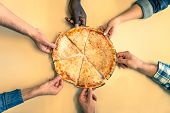 image of take out pizza  - Six friends sharing a pizza in a restaurant  - JPG