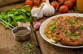 stock photo of cumin  - Fried potato pancakes with garlic and marjoram sprinkled cumin chive and coarse - JPG