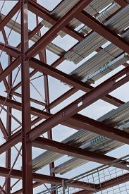 image of tatas  - A detailed view of red steel structure and standard metal profiled decking - JPG
