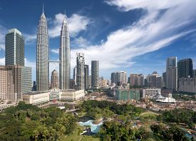 stock photo of petronas twin towers  - panoramic view of Kuala Lumpur downtown in daytime - JPG