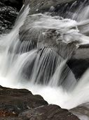 stock photo of dick  - waterfall over rocks at dicks creek fall north georgia - JPG