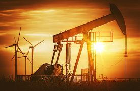 picture of fuel pump  - Renewable Wind Energy vs Fossil Fuels Concept Photography - JPG