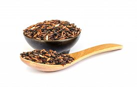 picture of rice  - close up of Thai rice berry with a wooden spoon or Thai black jasmine rice - JPG