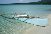picture of camiguin  - outrigger canoe on the white sand beaches of camiguin island in the philippines - JPG