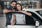 Couple At Car Dealership poster