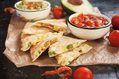 Mexican quesadillas, cheese and vegetables filled tortilla wraps with salsa and guacamole poster