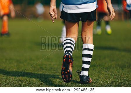 Legs Of Boy Footballer In