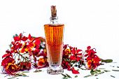 Close Up Shot Of Perfume Or Scent Of Peacock Flower In A Transparent Bottle Along With Raw Flowers I poster