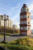 picture of murmansk  - Memorial red brick light tower on the hill in Murmansk Russia - JPG
