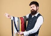 Guy With Beard Choosing Necktie. Perfect Necktie. Select Tie That Has Colors Of Your Suit And Shirt  poster
