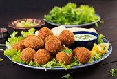 Falafel, Hummus And Pita. Middle Eastern Or Arabic Dishes On A Dark Background. Halal Food. poster