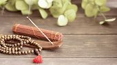 Stick Holder With  Burning Incense Stick  And Mala Beads For Meditation And Relax. poster