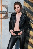 Fashion Shot: Portrait Of Sexy Lovely Rock Girl (informal Model) Dressed In Black Leather Jacket And poster