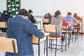 Behind Group Of Asian High School, University Student Having Test Exams For Taking Writing Examinati poster