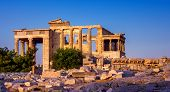 View Of Erechtheion And Porch Of Caryatids On Acropolis In Athens, Greece, At Sunset poster