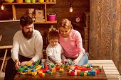 Game Concept. Son With Mother And Father Play Construction Game. Little Child Learning Through Game. poster