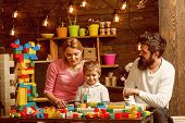 Building Concept. Little Son With Mother And Father Play With Building Blocks. Building Social Skill poster