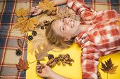 Girl In Autumn In A Seasonal Clothes Whith Golden Leaf. Autumn Discounts. Girl Wearing In Autumn Clo poster