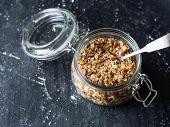 Nuts, Seeds, Goji Berries Granola In Open Glass Jar. Healthy Breakfast - Homemade Granola In A Jar O poster