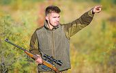 Guy Hunting Nature Environment. Bearded Hunter Rifle Nature Background. Hunting Hobby Concept. Hunti poster