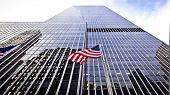 pic of usa flag  - Flag of the United States of America in front of the office building - JPG
