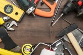 Different Construction Tools On Wooden Background With Copy Space. Top View Of Diy Construction Tool poster