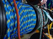 Blue Rope On A Show-window Of Shop. A Saving Rope For Climbers. The Rope Is Reeled Up On The Coil. T poster