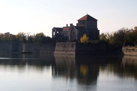stock photo of tatas  - A semi shilouett of Castle of Tata next to the Old Lake - JPG