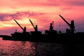 stock photo of dredge  - Dredge sand ship working in the sea in twilight silhouette - JPG