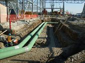 pic of pipefitter  - pipe fitters lay large pipe line on industrial construction site - JPG