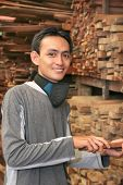 picture of masker  - Man at Lumber or timber with mask on his neck - JPG