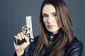 picture of breastplate  - Dangerous woman holding up her gun in studio - JPG