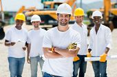 picture of real-estate-team  - Happy group of construction workers at a building site  - JPG