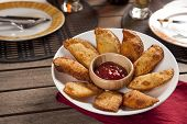 foto of pasteis  - Pastel a Brazilian snack with a bar in the background - JPG