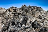image of obsidian  - A huge pile of obsidian and pumice - JPG