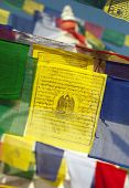 stock photo of mantra  - Prayer flags with mantras and prayer symbols - JPG