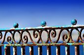 pic of balustrade  - blue rusty balustrade on the sea front - JPG