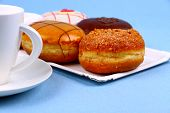 Five Delicious, Assorted Donuts With Coffee