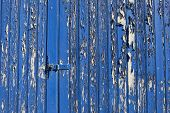 picture of hasp  - background pattern and texture of an old wooden door with weathered blue paint and hasp and staple lock - JPG