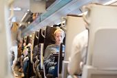 foto of passenger train  - Blonde casual caucasian lady traveling by train - JPG