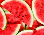 picture of watermelon  - Abstract background with slices of fresh ripe red watermelons - JPG