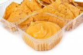 stock photo of nachos  - nachos chips with cheese sauce in plastic container on white background - JPG