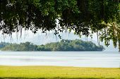 picture of chan  - Landscaped lawns for relaxing waterfront under the tree at Kaeng Kra Chan National Park in Phetchaburi Province Thailand - JPG