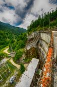 image of hydro  - Small hydro electric dam harnessing water power in a mountain area - JPG