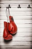 picture of knockout  - Boxing gloves hanging on wooden wall  - JPG