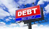 stock photo of debenture  - Debt Inscription on Red Billboard on Sky Background - JPG
