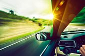stock photo of speeding car  - Driving Down the Road - JPG